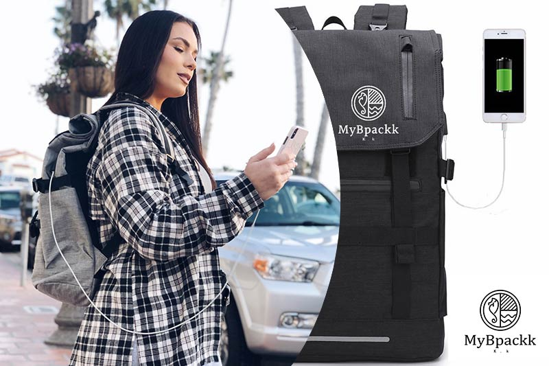 Best Backpack with Power Supply for 2020 - woman on side of road with backpack and mobile phone on charge